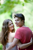 Attractive romantic teenage couple looking back Royalty Free Stock Photos