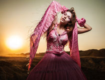 Attractive romantic woman on beautiful pink dress pose outdoor. Stock Photography