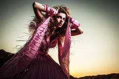 Attractive romantic woman on beautiful pink dress pose outdoor. Royalty Free Stock Images