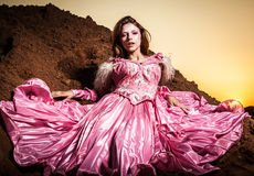 Attractive romantic woman on beautiful pink dress pose outdoor. Royalty Free Stock Photography