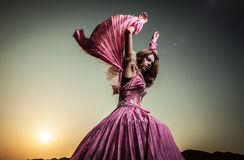 Attractive romantic woman on beautiful pink dress pose outdoor. Stock Images