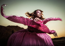 Attractive romantic woman on beautiful pink dress pose outdoor. Stock Photo