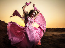 Attractive romantic woman on beautiful pink dress pose outdoor. Royalty Free Stock Photos