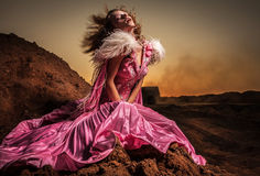 Attractive romantic woman on beautiful pink dress pose outdoor. Stock Image