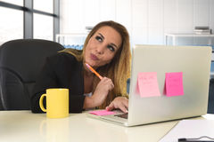 Attractive 40s blond businesswoman working at office laptop comp Royalty Free Stock Photography