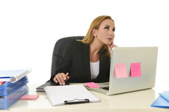 Attractive 40s blond businesswoman working at office laptop computer Royalty Free Stock Photo