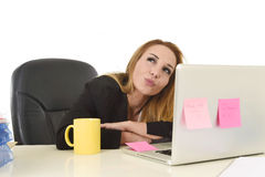 Attractive 40s blond businesswoman working at office laptop computer Royalty Free Stock Image