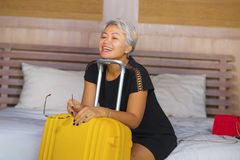 Attractive 40s to 50s mature Asian tourist woman with grey hair arriving in hotel room excited smiling  cheerful enjoying business. Happy and attractive 40s to stock photography