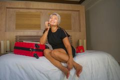 Attractive 40s to 50s mature Asian tourist woman with grey hair arriving in hotel room excited smiling  cheerful enjoying business. Happy and attractive 40s to royalty free stock image