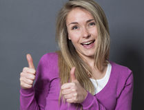 Attractive 20s woman with double thumbs up Stock Images