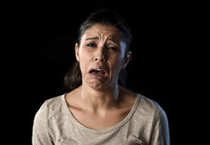 Attractive sad and desperate Latin woman crying frustrated suffering problems in sadness and stress Stock Image