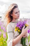 Attractive sad girl on meadow Royalty Free Stock Images