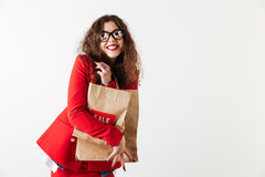 Attractive sale woman holding paper shopping bags isolated over white Stock Image