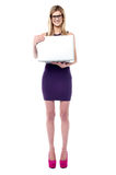 Attractive sales girl holding laptop Royalty Free Stock Photos