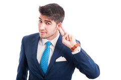 Attractive salesman listening some whispers stock image
