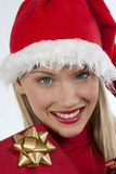 Attractive Santa girl. Rich, colorful series of attractive young woman in santa's hat with presents Stock Photos