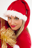 Attractive Santa girl with present Stock Photo