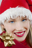 Attractive Santa girl with present Stock Photography