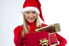Attractive santa girl with presents. Rich, colorful series of attractive young woman in santa's hat with presents Stock Photos