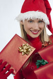 Attractive Santa girl with presents Royalty Free Stock Image
