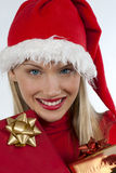 Attractive santa girl with presents. Rich, colorful series of attractive young woman in santa's hat with presents Royalty Free Stock Photography