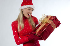 Attractive santa girl with presents. Rich, colorful series of attractive young woman in santa's hat with presents Royalty Free Stock Photos