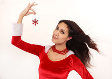 Attractive Santa girl with snowflake Stock Photos