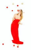 Attractive santa girl throwing xmas balls Royalty Free Stock Photo
