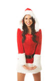 Attractive santa woman standing astride and inclined, looking to the camera.  Stock Photo