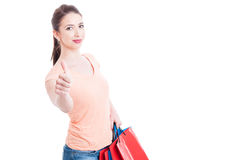 Attractive and satisfied young shopping woman showing like gesture. Isolated on white background with copy space area royalty free stock images