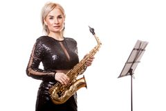 Attractive saxophonist woman playing at her musical instrument Royalty Free Stock Photo