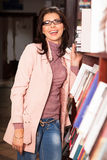 Attractive school teacher in bookshop Royalty Free Stock Photography