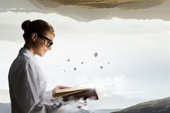 Scientist woman doing research. Mixed media. Attractive scientist woman with book in hands. Mixed media Stock Photos