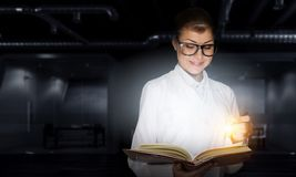 Scientist woman doing research. Mixed media. Attractive scientist woman with book in hands. Mixed media Royalty Free Stock Photos