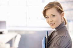 Attractive secretary holding folders Stock Image