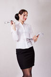 Attractive secretary holding papers Royalty Free Stock Photos