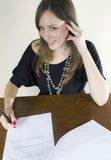 Attractive secretary signing and smiling Royalty Free Stock Photos
