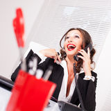 Attractive secretary talking on the phone Stock Image