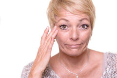 Free Attractive Senior Blond Woman Checking Her Complexion Stock Photos - 51484373