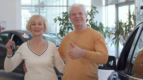 Senior couple buys the car at the dealership stock photos