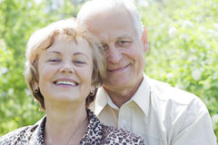Attractive senior couple smiling. Closeup portrait of a smiling cute senior couple royalty free stock images