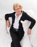 Attractive senior lady on a sofa Royalty Free Stock Photo