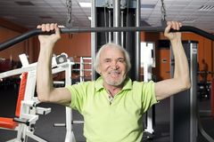 Elderly man in the gym Stock Images