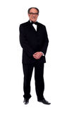 Attractive senior man posing in tuxedo. Isolated over white background Stock Photo