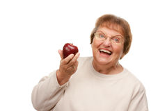 Attractive Senior Woman with Apple Royalty Free Stock Image