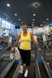 Attractive senior woman exercising at gym Stock Image
