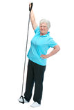 Attractive senior woman at health club. Doing exercises with a chest expander Stock Photography