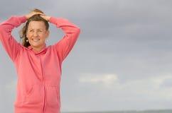 Attractive senior woman posing at beach Stock Photo