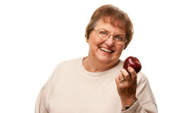Attractive Senior Woman with Red Apple Stock Images