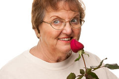 Attractive Senior Woman with Red Rose Royalty Free Stock Photo
